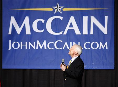 Republican presidential candidate John McCain looks up to attendees and smiles at a town hall meeting in Indianapolis February 22, 2008. McCain said on Friday he was not concerned over the possibility of severe campaign funding restraints from the agency that oversees money in U.S. politics. REUTERS/Brent Smith