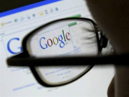 A Google search page is seen through the spectacles of a user in Leicester in this July 20, 2007 file photo. Neither Microsoft Corp nor Yahoo Inc want to blink first in the software giant's proposed $41.7 billion takeover of the Web pioneer but as gamesmanship drags on, archrival Google Inc is the biggest beneficiary. REUTERS/Darren Staples/Files