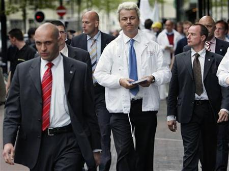 Dutch populist politician Geert Wilders (C) walks the streets during his one-man campaign in Eindhoven, The Netherlands, May 17 2005. REUTERS/Michael Kooren