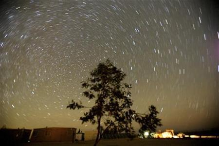 Stars are seen in the desert sky November 18, 2006. British spies hired an astrologer during World War Two, although many thought he was a fraud, and even sent him to the United States on a propaganda mission, secret documents released on Tuesday revealed. REUTERS/Ali Jarekji