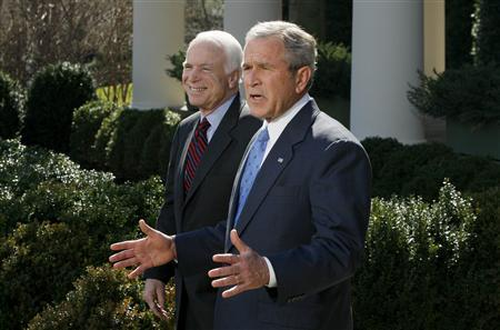 President George W. Bush welcomes Republican Presidential candidate John McCain to the White House Rose Garden in Washington, March 5, 2008. REUTERS/Jason Reed
