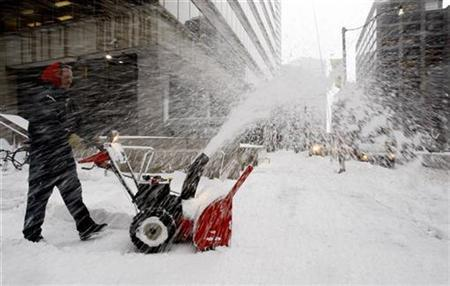 A worker clears snow in downtown Toronto February 1, 2008. Although Canada is one of the snowiest countries in the world, a series of violent ''snow rage'' incidents reveal that even the locals have their limits. REUTERS/Mark Blinch