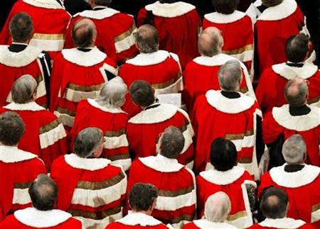 Members of the House of Lords listen as Britain's Queen Elizabeth delivers her speech to the House of Lords at the Palace of Westminster, during the State Opening of Parliament in London, November 23, 2004. REUTERS/Jamie Wiseman/The Daily Mail/Pool