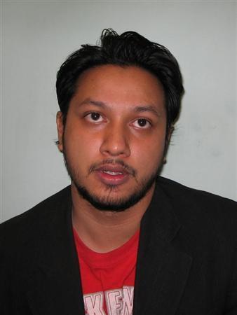 Police handout photo of Abdul Mukim Khalisadar. REUTERS/Handout