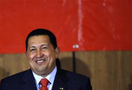 Venezuelan President Hugo Chavez attends an event to celebrate victory over Exxon Mobil in Caracas March 24, 2008. REUTERS/Jorge Silva