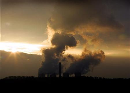 In this file photo the Sun sets behind Ratcliffe on Soar Power Station in central England, December 8, 2004. A landmark Climate Change Bill, which for the first time sets a legal requirement on a government to cut carbon emissions, is expected to pass its first parliamentary hurdle on Monday but has a rocky ride ahead. REUTERS/Darren Staples