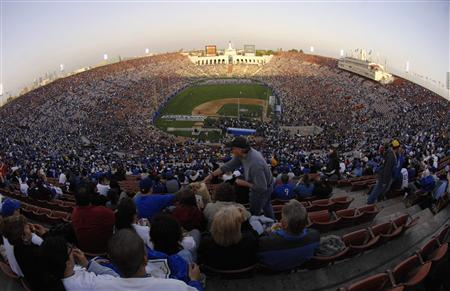 Record crowd watches Dodgers v Red Sox exhibition - Reuters