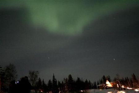 The Northern Lights appear in the sky over the woods in Canada's Northwest Territories in this picture taken February 14, 2008. REUTERS/Cameron French