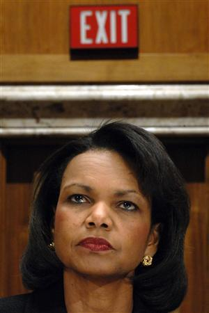 Secretary of State Condoleezza Rice sits beneath an exit sign testifies before the Senate Appropriations Committee on Capitol Hill in Washington, April 9, 2008. REUTERS/Jonathan Ernst