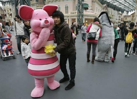 Tokyos disney eyes new markets as japan ages reuters a thai tourist poses with disney character piglet at tokyo disneyland in urayasu north of m4hsunfo