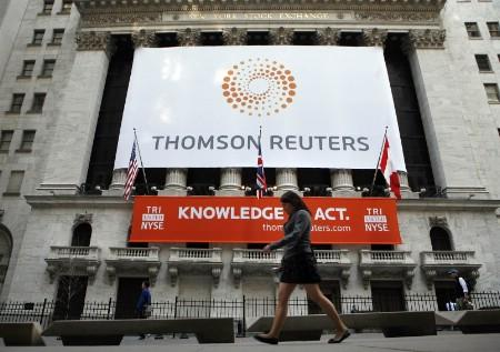 The front of The New York Stock Exchange displays the new Thomson Reuters logo as the stock is traded for the first time in New York April 17, 2008. REUTERS/Brendan McDermid (UNITED STATES)