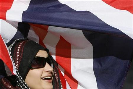 A woman protesting terrorism stands in front of the Union Jack flag near the Prime minister's official residence in Downing Street, September 11, 2007. REUTERS/Toby Melville
