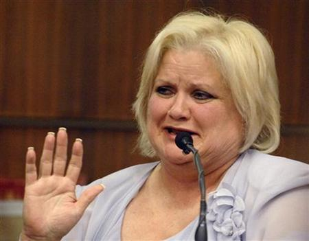 Virgie Arthur, the mother of the late entertainment celebrity Anna Nicole Smith, asks for a break to compose herself during a hearing in Broward County Circuit Court in Ft. Lauderdale, Florida February 21, 2007. REUTERS/Lou Toman/Sun-Sentinel/Pool