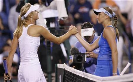 Russia's Maria Sharapova (L) and Slovakia's Daniela Hantuchova (R) shake hands after Sharapova's victory at the Pacific Life Open tennis tournament in Indian Wells, California March 19, 2008. REUTERS/Danny Moloshok