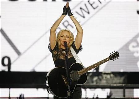 Singer Madonna performs during a concert to celebrate the launch of her new album ''Hard Candy'' in New York April 30, 2008. REUTERS/Lucas Jackson