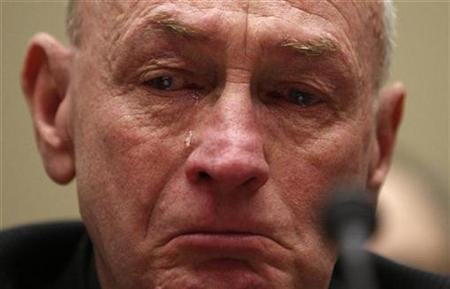 A tear rolls down the face of Leroy Hubley as he listens during a House Energy and Commerce subcommittee hearing on heparin imports from China on Capitol Hill in Washington April 29, 2008. REUTERS/Jim Young