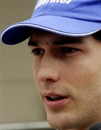 Bruno Senna, nephew of late Brazilian Formula One driver Ayrton, talks to journalists in the pit lane at the Interlagos race track in Sao Paulo, as teams prepared for Sunday's running of the Brazil Grand Prix, the last race of the season, October 20, 2006. REUTERS/Sergio Moraes
