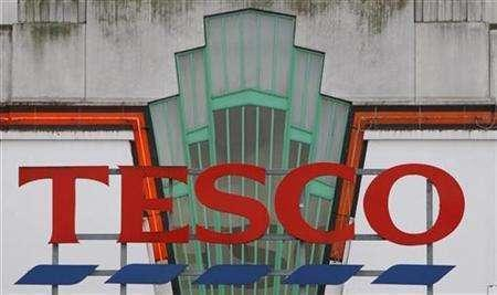 A Tesco logo is seen on the outside of the Old Hoover Building branch in west London, January 15, 2008. REUTERS/Toby Melville