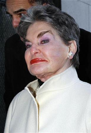 Real estate baroness Leona Helmsley appears for court to fight a former hotel manager's charges that she discriminates against homosexuals in New York on January 21, 2003. The pink wool and denim skirt suit worn by the late Helmsley when she went prison in 1992 sold for $850 at auction on Sunday. REUTERS/Chip East