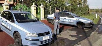 <p>Alcuni agenti di polizia in una immagine di archivio REUTERS/Marco Bucco</p>
