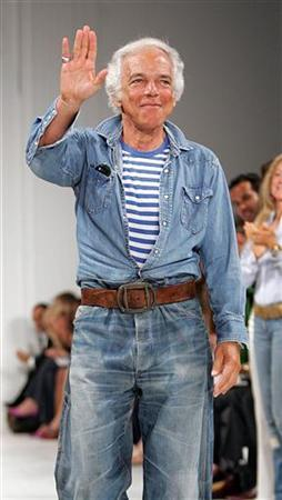 Ralph Lauren waves to an applauding crowd after his show at Fashion Week in New York September 16, 2005. REUTERS/Seth Wenig
