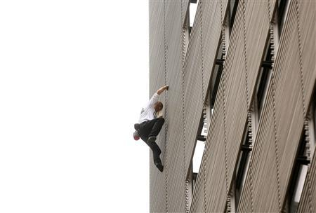 French Spiderman Scales New York Times Building Reuters