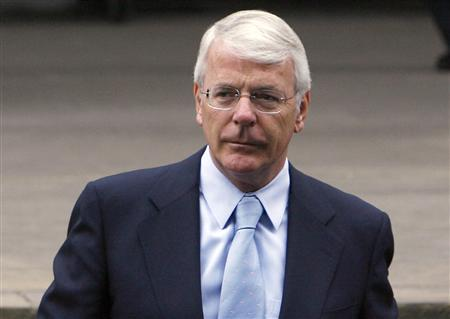 Former Prime Minister John Major arrives for the Service of Thanksgiving for the Life of Diana at the Guards' Chapel at Wellington Barracks in London, August 31, 2007. REUTERS/Pool/Leon Neal/WPA/AFP