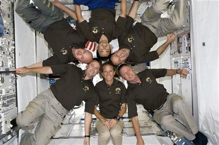 STS-124 crew members pose for a portrait following a joint news conference with the Expedition 17 crew members from the Kibo Japanese Pressurized Module of the International Space Station, while Space Shuttle Discovery is docked with the station, in this photo released by NASA June 10, 2008. Pictured clockwise from the bottom are NASA astronauts Karen Nyberg, mission specialists; Ken Ham, pilot; Mark Kelly, commander; Japan Aerospace Exploration Agency astronaut Akihiko Hoshide, NASA astronauts Ron Garan and Mike Fossum. REUTERS/NASA .