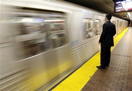 A transit rider waits for a subway car to stop on a platform in Union Station, Toronto's main commuter hub, in downtown Toronto, May 10, 2006. REUTERS/J.P. Moczulski