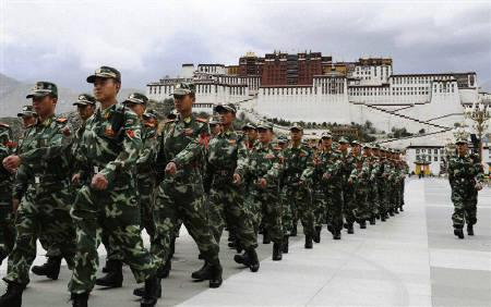People's Armed Police soldiers patrol in front of Potala Palace in Lhasa June 20, 2008. REUTERS/Kyodo