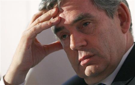Prime Minister Gordon Brown listens during a Low Carbon Economy Summit at Tate Modern in London June 26, 2008. REUTERS/Dominic Lipinski/Pool