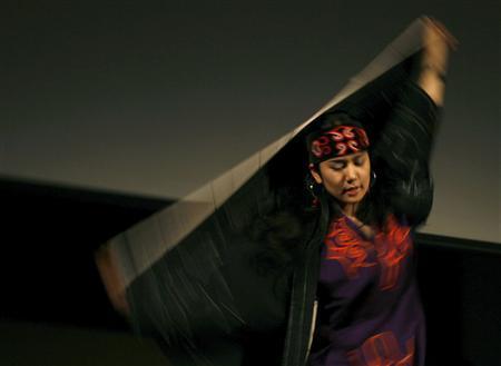 An Ainu woman performs during the Indigenous Peoples Summit in Sapporo, on Japan's northern island of Hokkaido, July 4, 2008 ahead of the G8 Hokkaido Toyako Summit. REUTERS/Yuriko Nakao