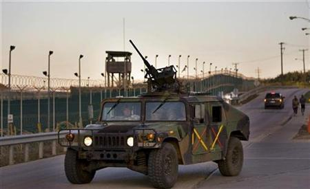 In this image reviewed by the U.S. Military, soldiers in a Humvee patrol the perimeter of the Camp Delta detention compound at Guantanamo Bay U.S. Naval Base in Cuba in this file photo from June 6, 2008 REUTERS/Brennan Linsley/Pool