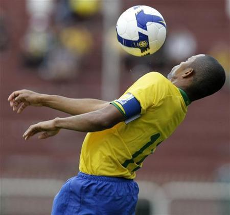 Robinho of Brazil's Olympic soccer team controls the ball during their friendly soccer match against the Rio de Janeiro state team at the Raulino de Oliveira stadium in Volta Redonda near Rio de Janeiro in this file picture. REUTERS/Sergio Moraes