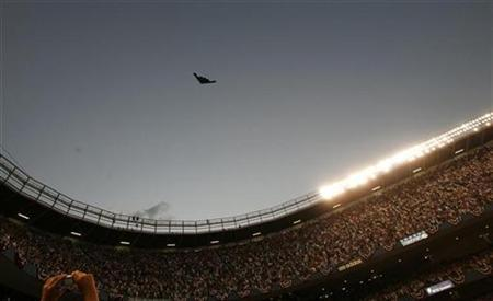 A B-2 stealth bomber flies over Yankee Stadium during pregame ceremonies for Major League Baseball's All-Star game in New York, July 15, 2008. REUTERS/Mike Segar