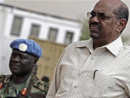 Sudans President Omar Hassan Al Bashir Stands Next To Force Commander Of The United Nations African Union Mission In Darfur UNAMID General Martin Luther
