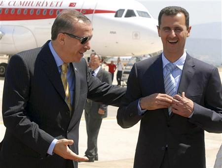 Turkey's Prime Minister Tayyip Erdogan (L) and Syria's President Bashar al-Assad share a laugh during al-Assad's arrival at Bodrum Airport in the southwestern Turkish resort of Bodrum August 5, 2008. REUTERS/Stringer