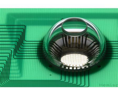A view shows the completed electronic eye camera, mounted on printed circuit board (green) for connection to a computer for image acquisition in this undated handout image. REUTERS/Beckman Institute, University of Illinois/Handout