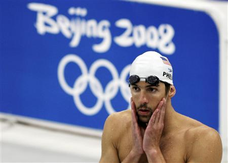Michael Phelps of the U.S. attends swimming practice at the National Aquatics Centre, also known as the Water Cube, ahead of the Beijing 2008 Olympic Games August 6, 2008. REUTERS/David Gray