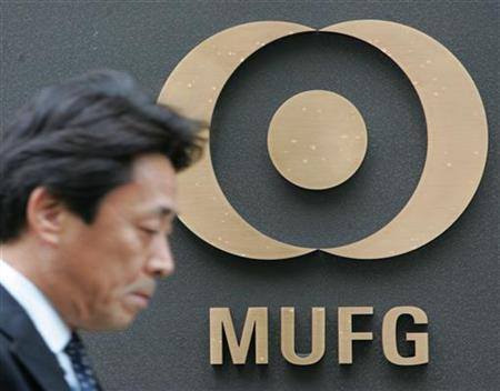 A man walks past the headquarters of Mitsubishi UFJ Financial Group in a file photo. Mitsubishi UFJ Financial Group Japan's largest bank, said it would bid $3 billion to buy the rest of UnionBanCal Corp a Californian bank it already owns two-thirds of, as it seeks growth beyond Japanese shores. REUTERS/Toshiyuki Aizawa