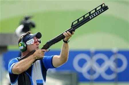 Silver medallist Francesco D'Aniello of Italy competes in the men's double trap shooting competition at the Beijing 2008 Olympic Games August 12, 2008. REUTERS/Desmond Boylan