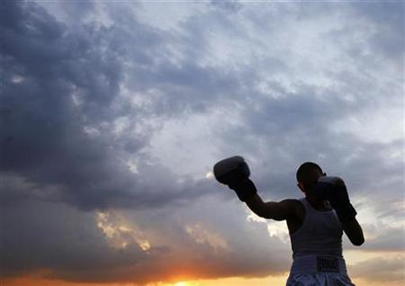 A boxer is seen outside Pier 84 in New York July 17, 2008. REUTERS/Shannon Stapleton