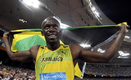 26c34fca247 Usain Bolt of Jamaica celebrates winning the men s 100m final of the  athletics competition in the National Stadium at the Beijing 2008 Olympic  Games August ...
