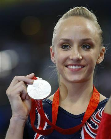 Nastia Liukin of the U.S. holds her silver medal on the podium during the medal presentation ceremony for the women's uneven bars final in the artistic gymnastics competition at the Beijing 2008 Olympic Games August 18, 2008.     REUTERS/Hans Deryk