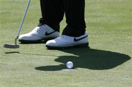 Anthony Kim of the U.S. makes a par putt on the 17th green during the second round of Ballantine's Championship golf tournament at the Pinx Golf Club in Seogwipo on Jeju Island March 14, 2008. REUTERS/Jo Yong-Hak