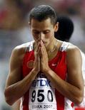 <p>Россиянин Юрий Борзаковский после полуфинала на чемпионате по легкой атлетике в Осаке, 31 августа 2007 года. Олимпийский чемпион Афин россиянин Юрий Борзаковский в четверг не смог пробиться в финал соревнований по бегу на 800 метров. REUTERS/Dylan Martinez (JAPAN)</p>