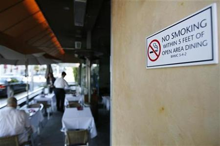 A no-smoking sign is seen outside a restaurant in Beverly Hills, California October 1, 2007. REUTERS/Mario Anzuoni