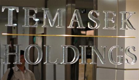 A man is reflected on a signboard outside Temasek Holdings headquarters in Singapore August 26, 2008. REUTERS/Tim Chong