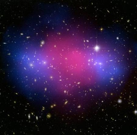 MACSJ0025.4-1222 in an undated Hubble and Chandra composite image of the galaxy cluster. Astronomers have captured images of a powerful collision of galaxy clusters and say it may shed light on the behavior of dark matter. REUTERS/NASA/Space Telescope Science Institute/Handout