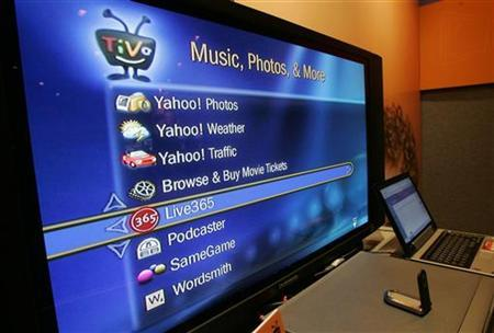 A screen shows Internet services available through an broadband-connected TiVo digital video recorder at the Consumer Electronics Show in Las Vegas, Nevada January 5, 2006. REUTERS/Steve Marcus